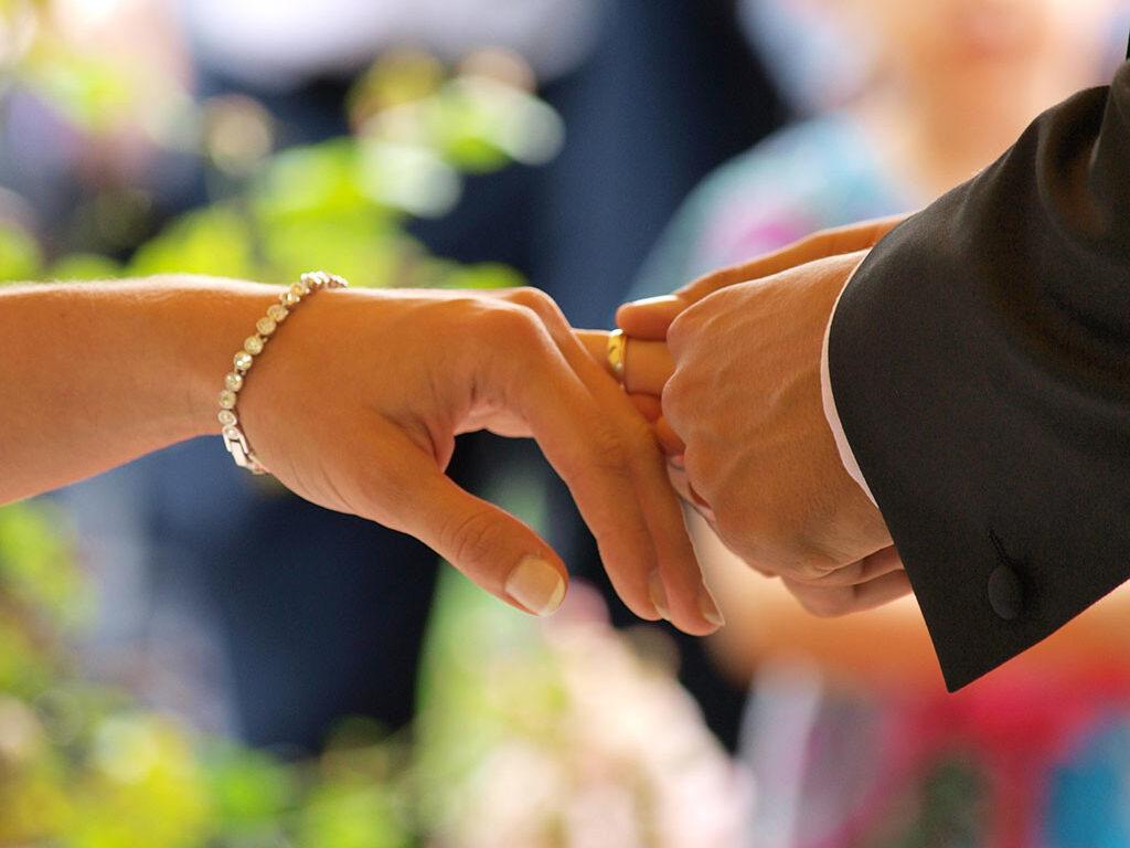 placing a wedding ring 1024x862