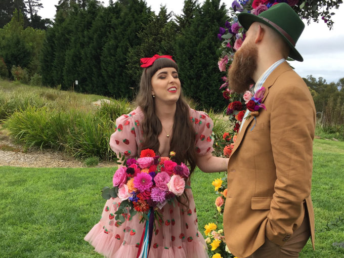 What is the meaning behind those flowers men wear at weddings?